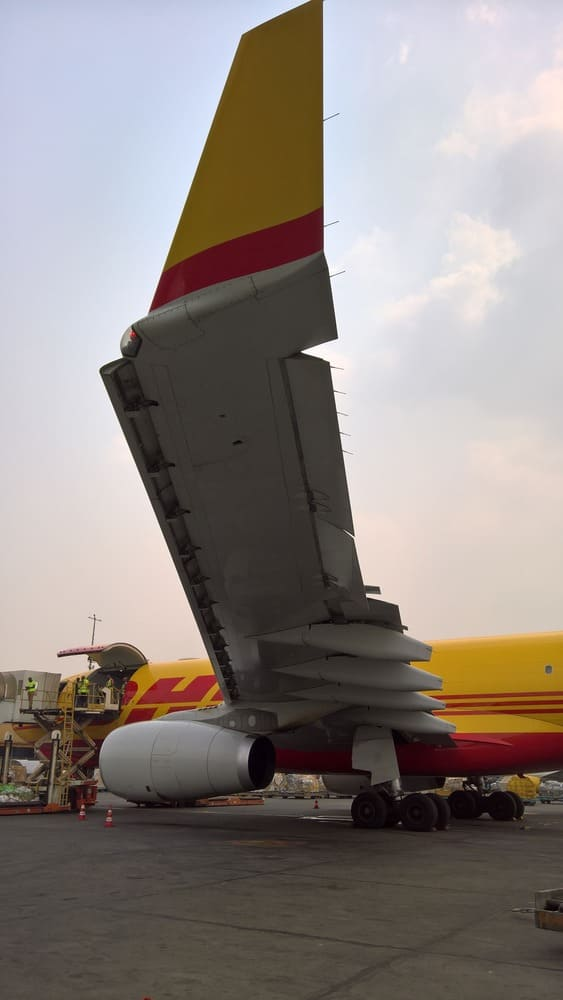 Slats extended, ailerons down